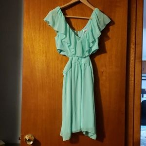Mint green dress with cutouts on both sides.